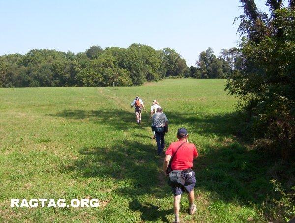 Hiking through a pasture