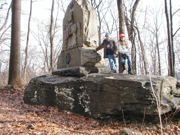Daryl & Madelyn next to a monument